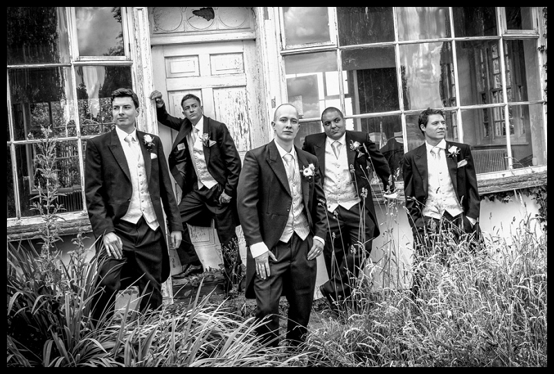Cool, moody black and white group shot of the groomsmen.jpg