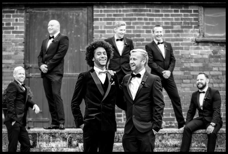 cool stylish fun photo of groom and groomsmen at smeetham hall barn