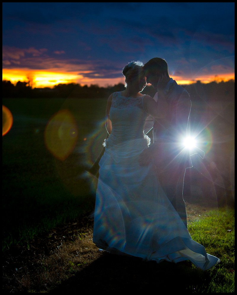 creative wedding photography of bride and groom at the granary barns