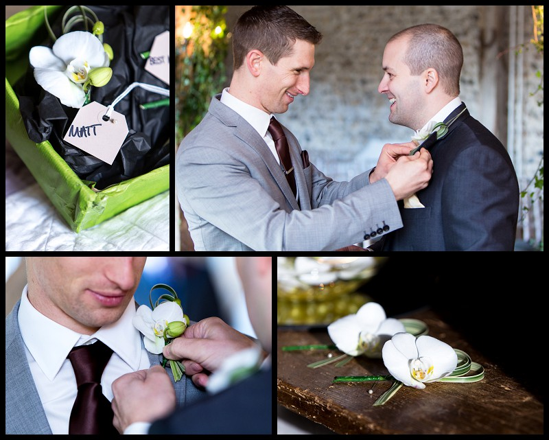 groom and best man putting on buttonholes At the granary barns