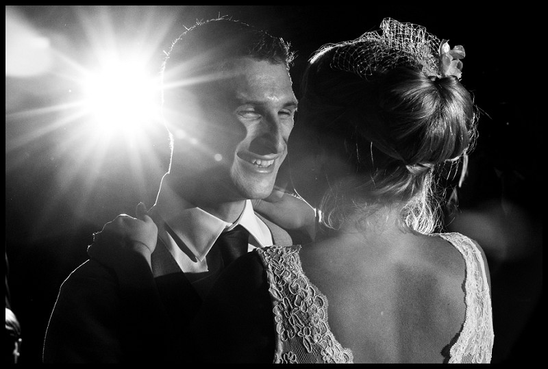 beautiful wedding photography of bride and groom dancing at the granary barns. With flashburst in background