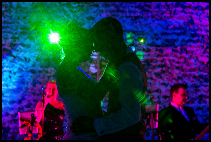 silhouette of bride and groom dancing at Granary Barns