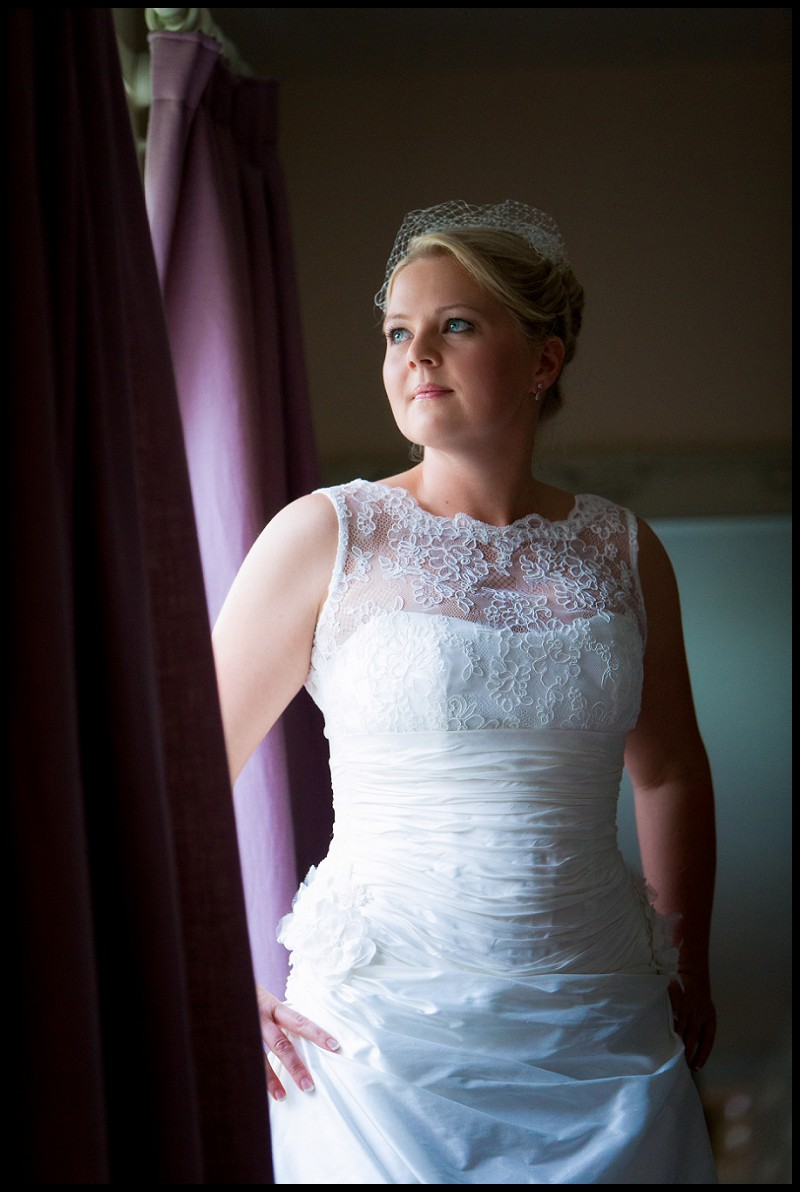 beautiful wedding photo of bride by window. At the Granary Estates