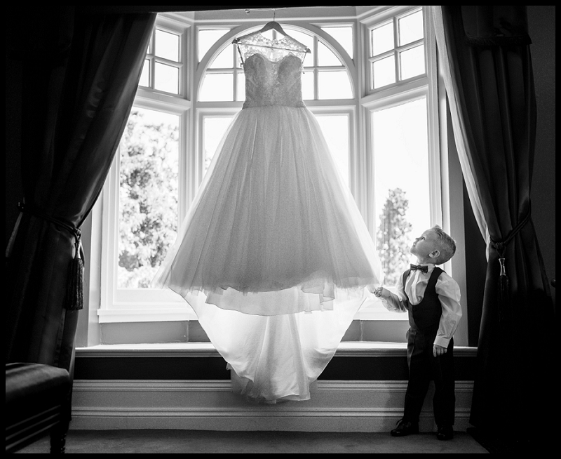 Boy looking at wedding dress