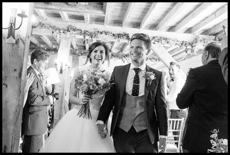 happy couple just married at granary flint barns