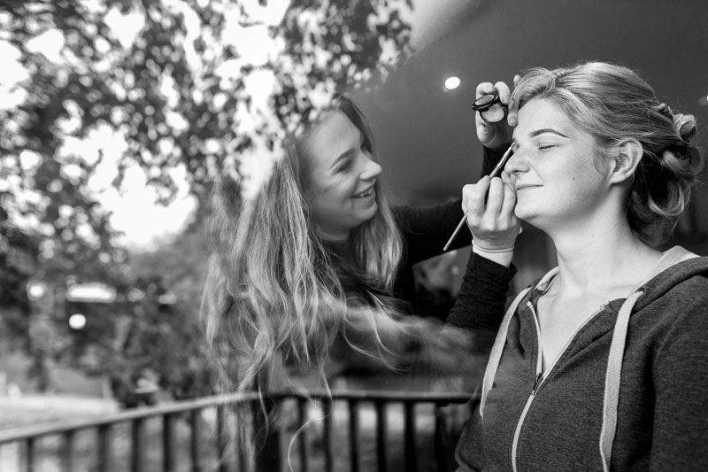 A bride having her make up applied at Rosewood Stud by Dani Roberts MUA