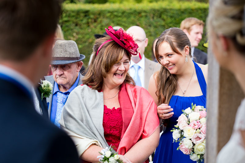 Mother of the bride and bridesmaid laughing