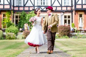 Bride and Groom walking hand in hand at a Norfolk Wedding Venue