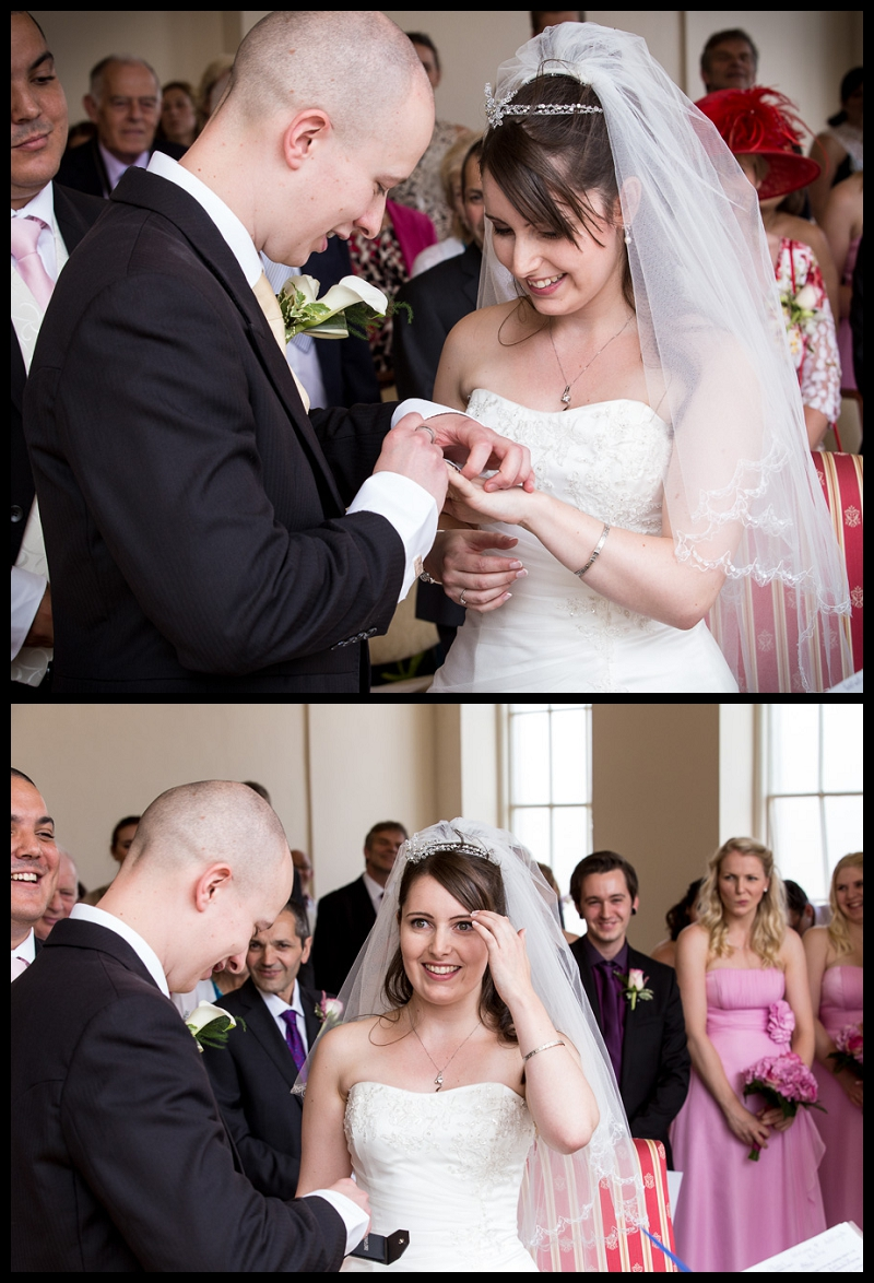Groom putting ring on brides finger (2).jpg