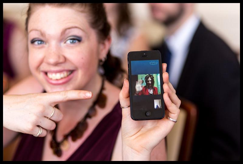 relative watching the wedding by Skype.jpg