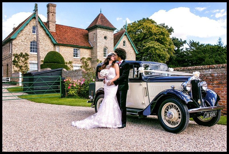 1940's style bride and groom with hillman minx at smeetham hall barn romantic portrait