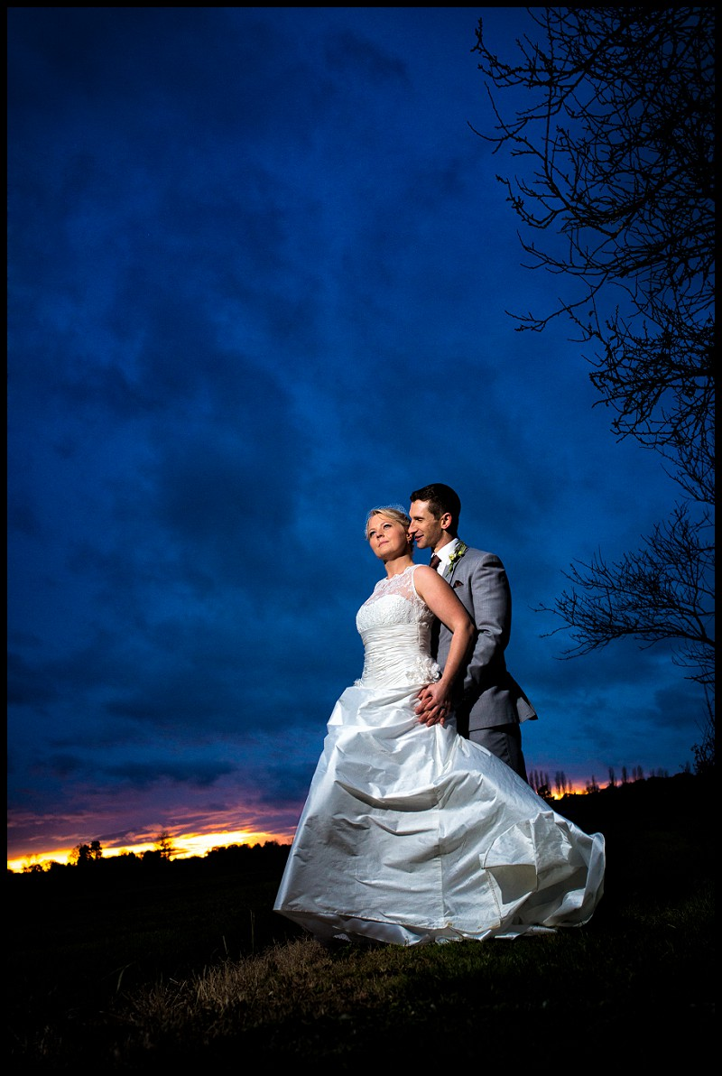 Cambridgeshire wedding photography of couple posing at sunset at granary estates