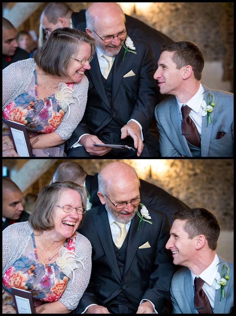 groom and parents sharing a joke at the granary barns