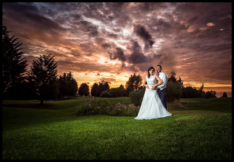 Bride and groom with dramatic Sunset on Channels golf course. Stunning wedding photography
