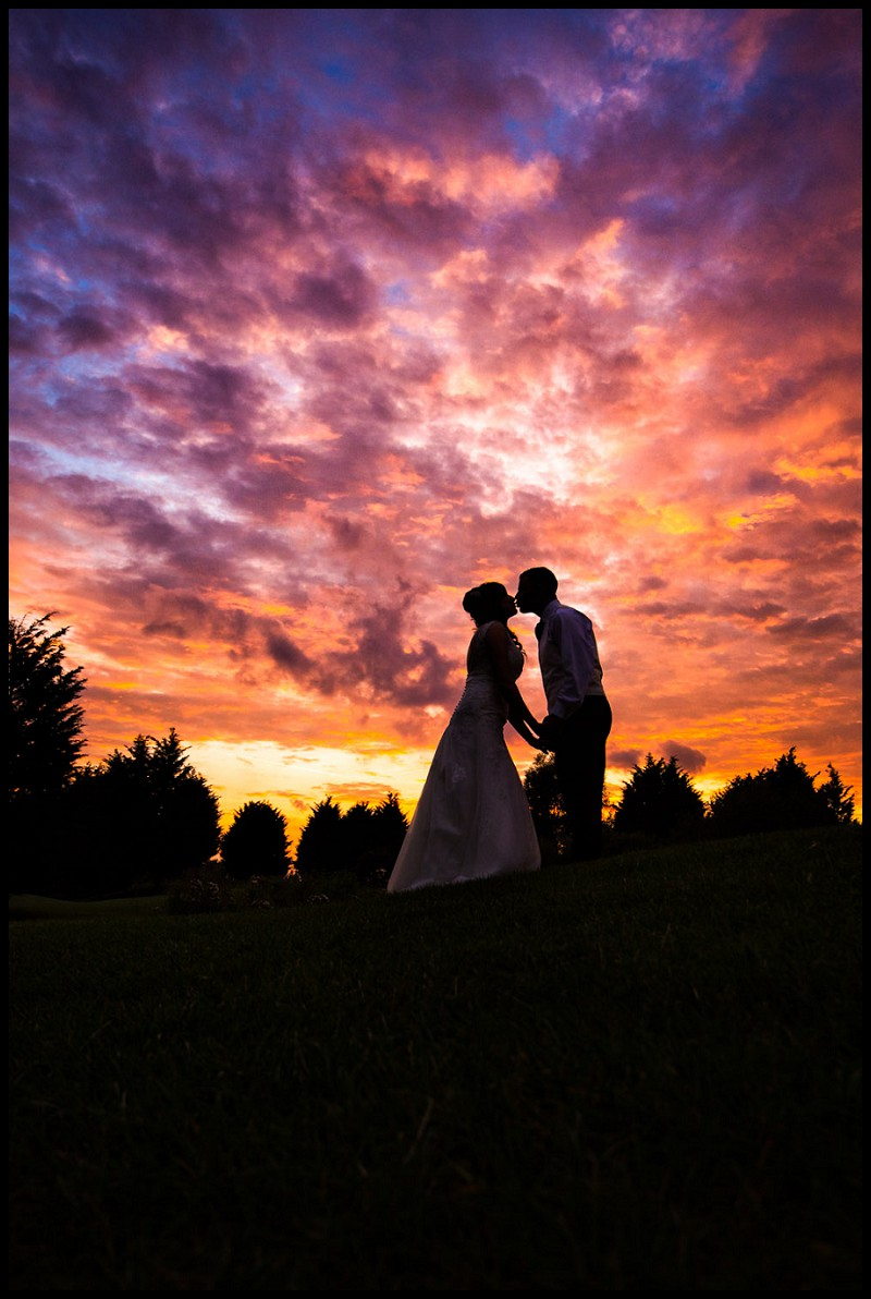 Bride and groom silhouette at Sunset at Channels Golf Club Essex wedding