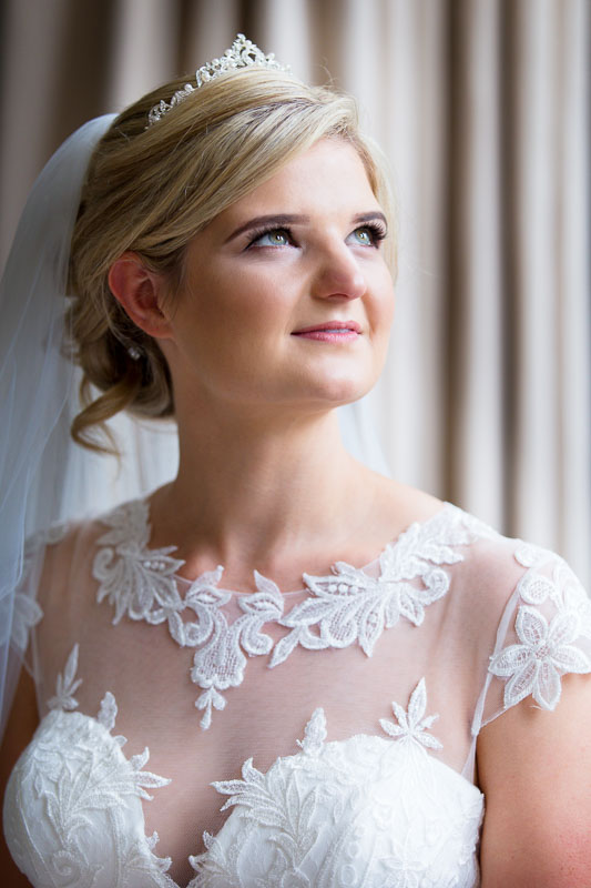 Head and shoulder portrait of bride in bridal suite at Chippenham Park wedding venue in Cambridgeshire