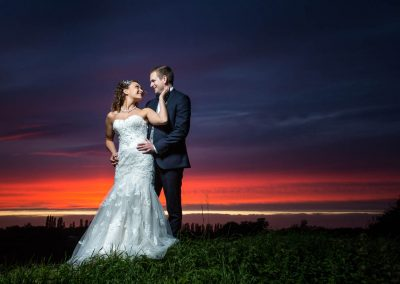 Beautiful Sunset with Bride and Groom and Granary Barns Wedding
