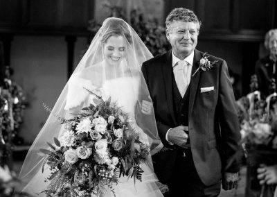 Bride and Father walkng down aisle at Norfolk Church Wedding