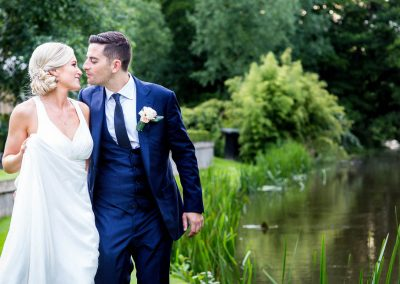 Bride and groom by river at La Talbooth Wedding