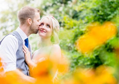 Chaucer Barn Wedding Couple in Flower Garden