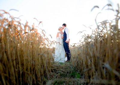 Granary Barns wedding. Couple in Corn Field