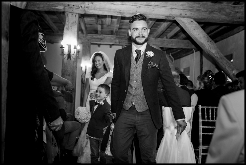 Bride and groom exiting The Granary Barns