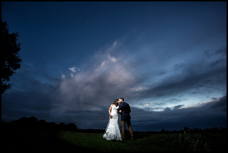 Bride and Groom with stunning sky landscape