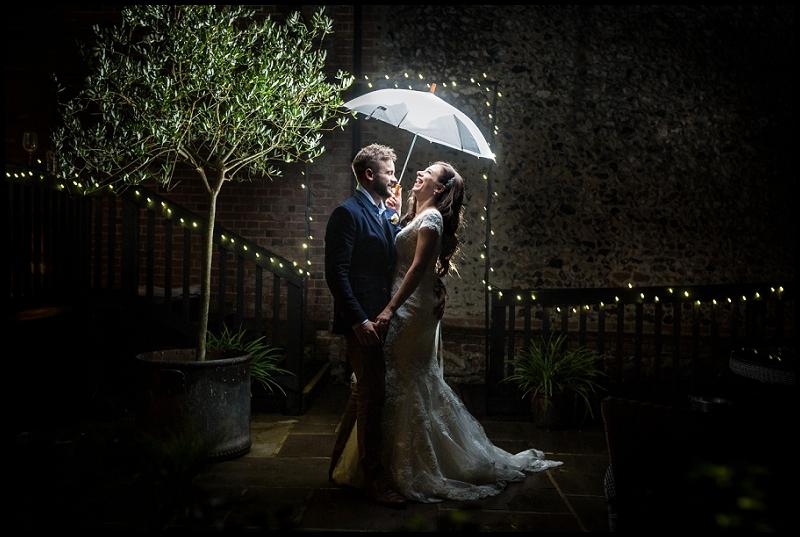 Granary Barns Wedding Bride and Groom with Umbrella