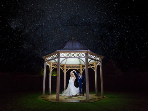 bride and groom dancing under the stars at Chippenham Park wedding venue