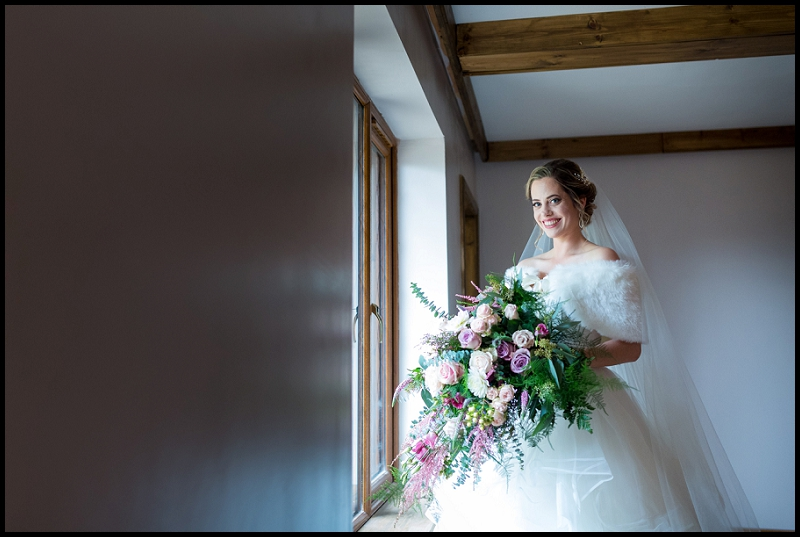 stunning bride next to window
