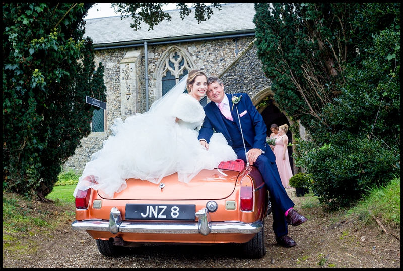 Bride and father on MG car