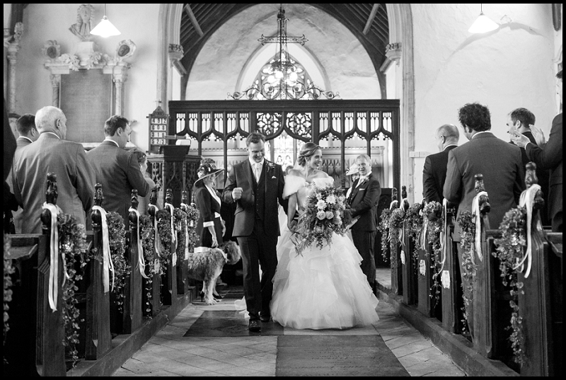 bride and groom exiting Colton church
