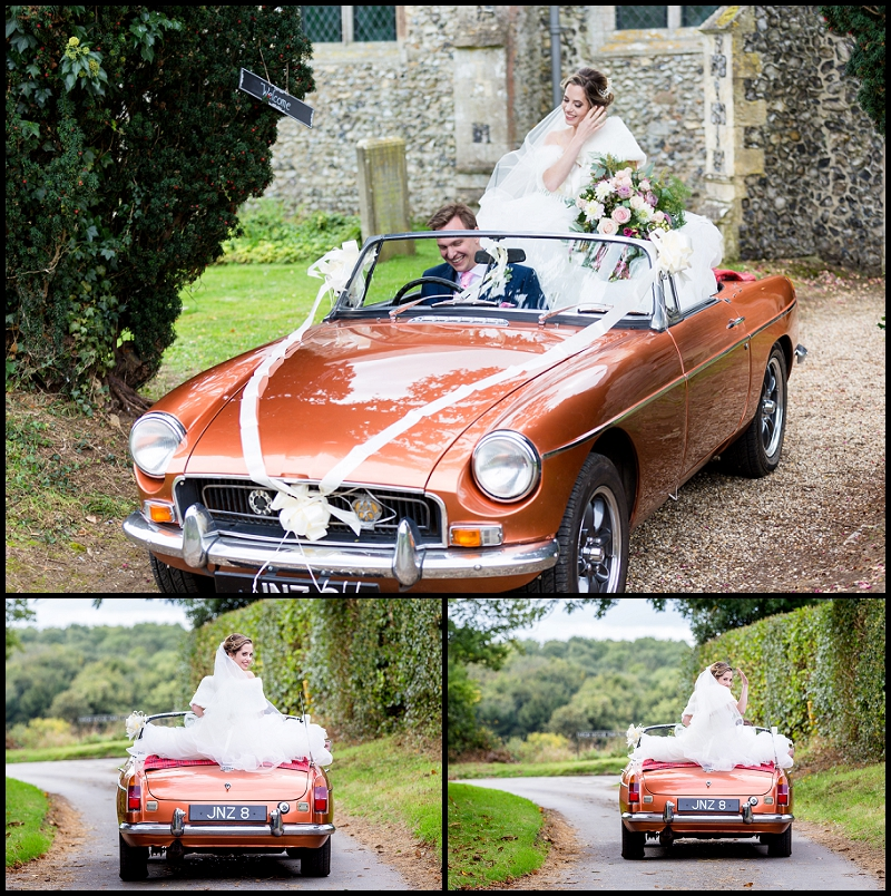 Groom driving Classic car with bride