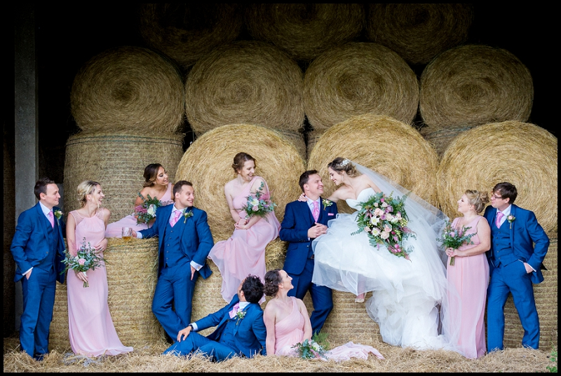 bridal party in barn on hay at pub wedding