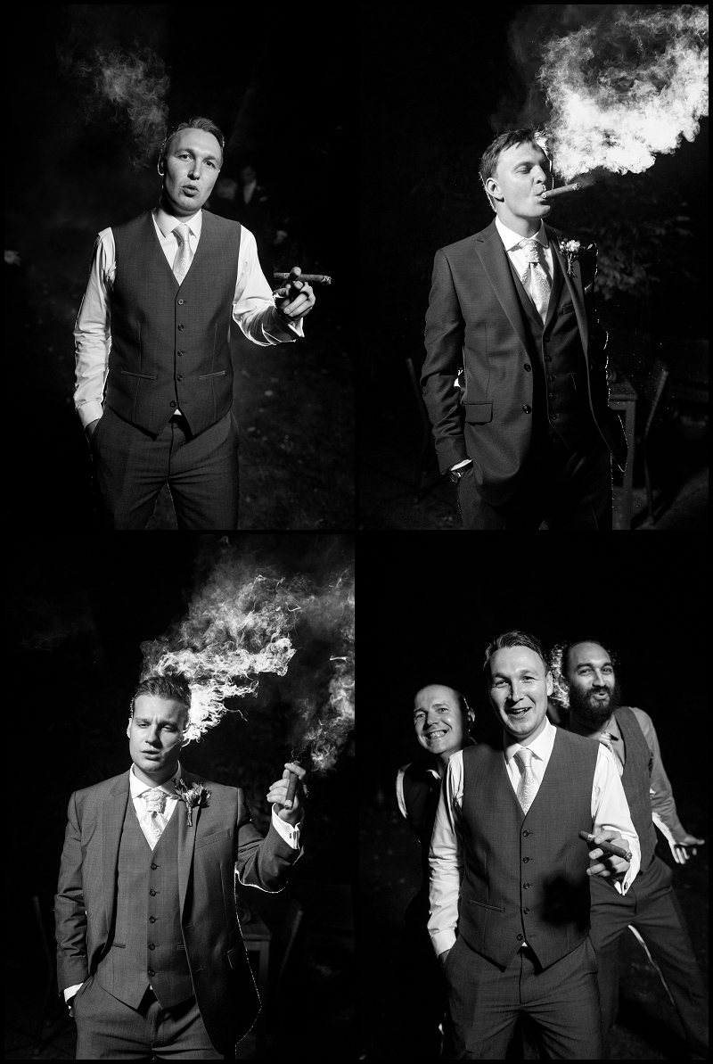 groomsmen smoking cigars at pub wedding