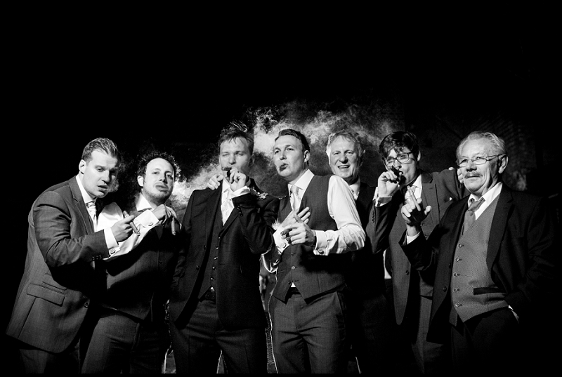 groom and ushers smoking ciagrs