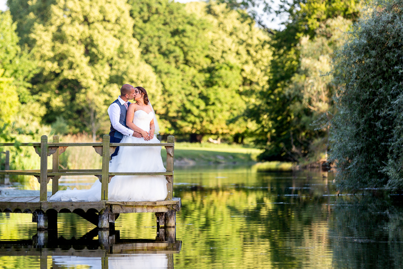 Couple kissing on jetty at Chippenham Park Wedding Venue