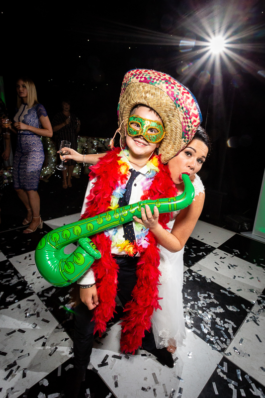 Bride and boy on dancefloor with fun wedding props