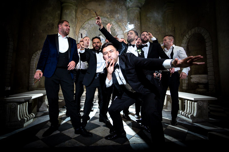 Cool posed group photo of groomsmen with cigars at Wotton House in temple