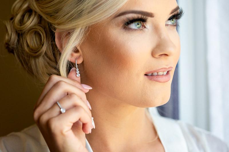 bride holding earring