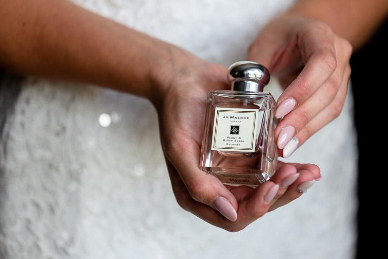 bride holding Jo Malone perfume