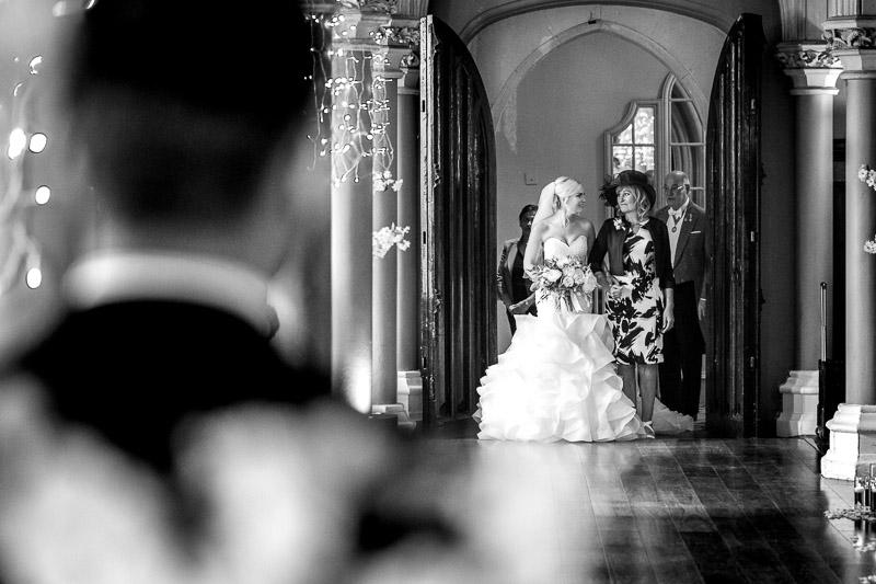 Bride walking down aisle of De Vere Wotton House