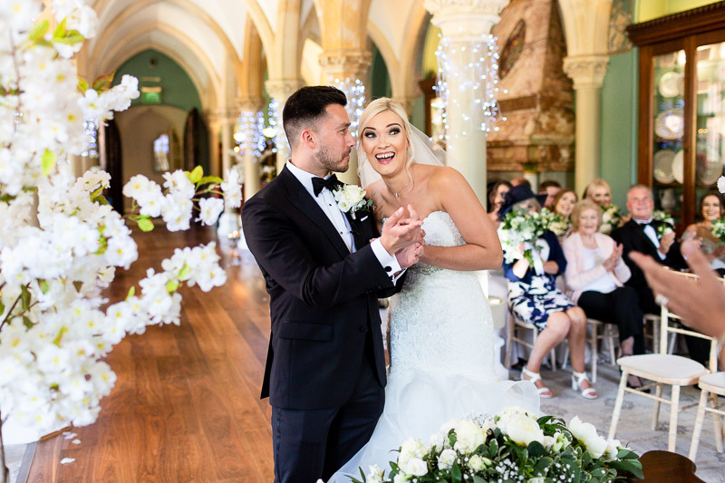 Groom misses first kiss as bride laughs