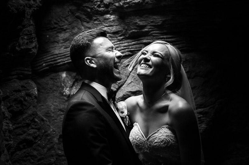 Bride and Groom laughing at De Vere Wotton House in cave