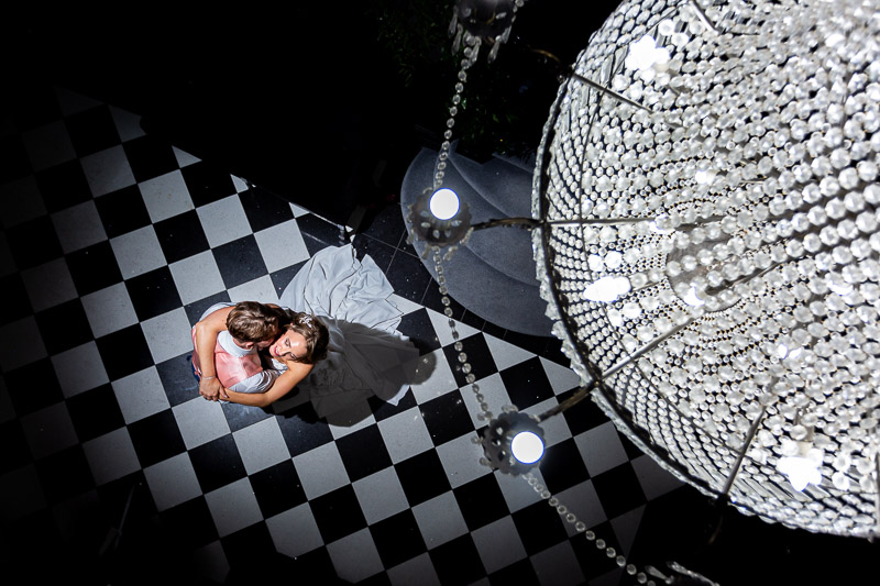 Bride and groom under chandelier at Swynford Manor wedding Venue