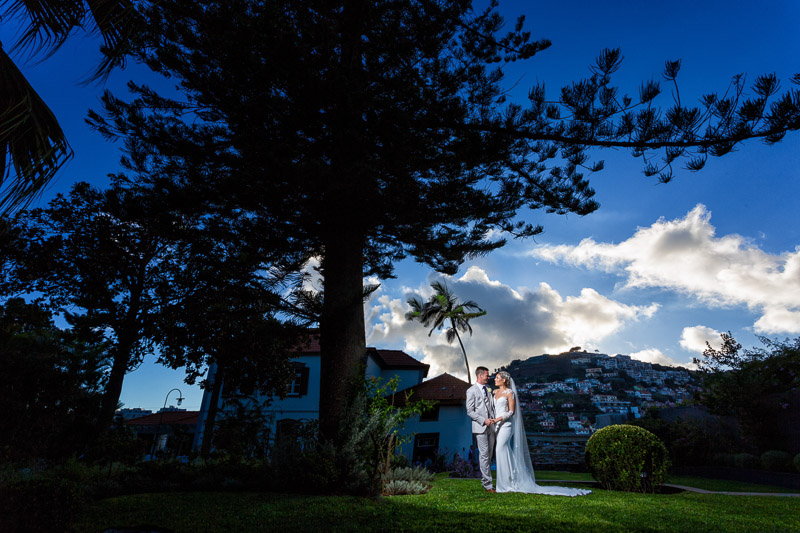 madeira wedding photography of bride and groom standing near quinta