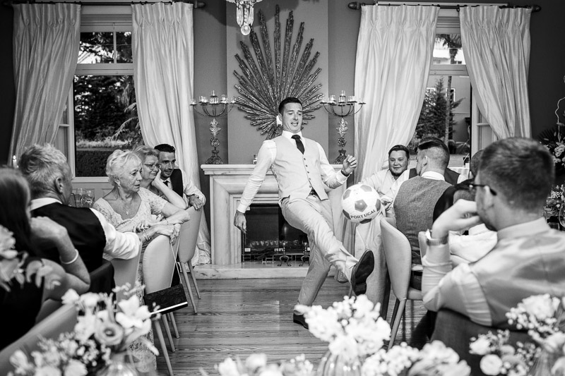 groom kicking football